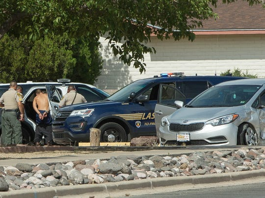 Doña Ana County sheriffs put a suspect in the back of a DASO unit Tuesday June 5, 2018 at the Church of Christ parking lot near the intersection of South Solano Drive and Panlener Avenue. The man is suspected of leading authorities on a vehicle pursuit through Las Cruces.