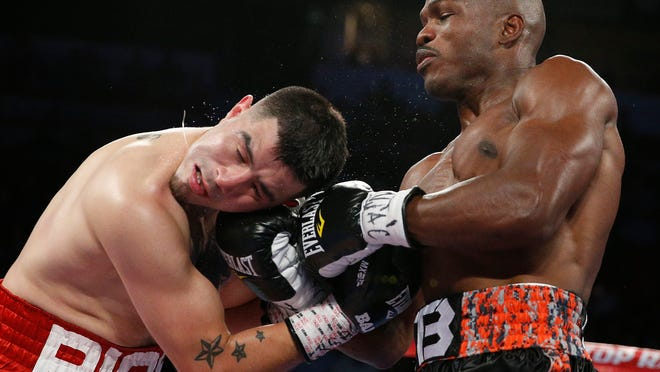 Timothy Bradley, right, hits Brandon Rios during a WBO welterweight title bout Saturday (AP Photo/John Locher)