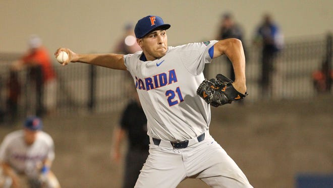 Florida starting pitcher Alex Faedo (21) throws against South Florida  during an NCAA college baseball tournament regional game Saturday, June 3, 2017, in Gainesville, Fla.