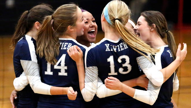 The Hawks celebrate a point during an Eastern Valley Conference girls' volleyball match against Fox Valley Lutheran on Sept. 18 in Appleton.