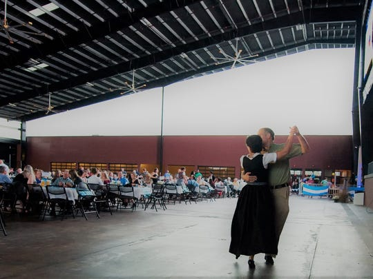 Oktoberfest attendees enjoy evening of live band performances at benefit events. The 19th Annual Oktoberfest is presented by Keith Lawson Services to benefit Elder Care Services.