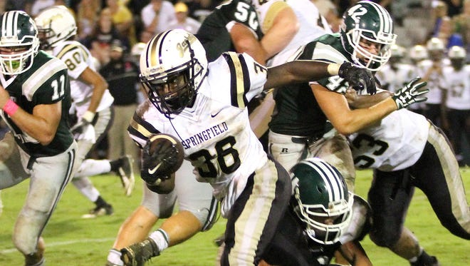 Ke'Lein Jones breaks a tackle and heads outside for a first down in Springfield's 14-0 win over Greenbrier.