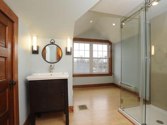 The third floor bathroom was originally part of the maid's quarters.