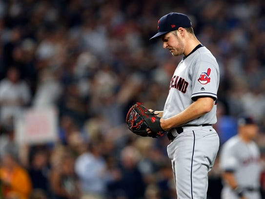 Indians starting pitcher Trevor Bauer reacts in the