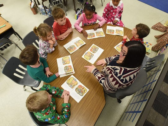 Erin Bailey, a first grade teacher at Fruitland Primary, works with students in her classroom on Dec. 16, 2016.