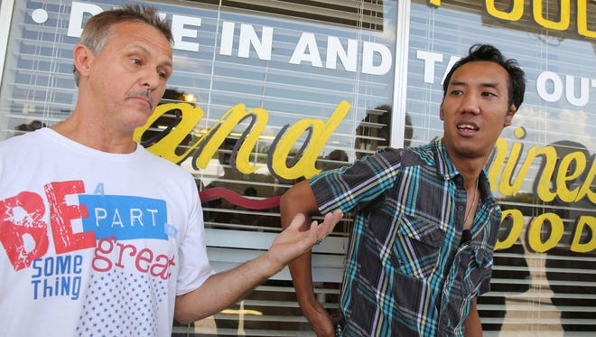 Michael Ritrovato, left, and restaurant owner Nutpisit Suthamtewakul speak about working with Aaron Alexis, who was once employed by Suthamtewakul, on Sept. 16 in Fort Worth.