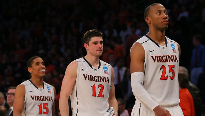 The Virginia Cavaliers walk off the court after a season-ending loss to Michigan State.