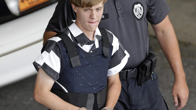 In this June 18, 2015 file photo, Charleston, S.C., shooting suspect Dylann Roof is escorted from the Cleveland County Courthouse in Shelby, N.C. A federal jury has sentenced Roof to death for killing nine black church members in a racially motivated attack in 2015. FILE - In this June 18, 2015 file photo, Charleston, S.C., shooting suspect Dylann Roof is escorted from the Cleveland County Courthouse in Shelby, N.C. A federal jury has sentenced Roof to death for killing nine black church members in a racially motivated attack in 2015. (AP Photo/Chuck Burton, File)