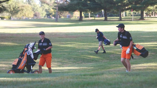 Macomb boys golfers Braeden Duncan and Jack Lockard walk the course at Macomb Country Club earlier this season.