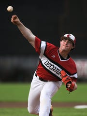Decatur's Tanner Burns pitches during the game in Hartselle