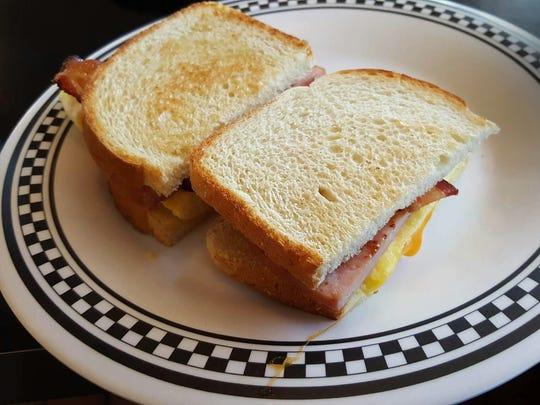 The Sunrise Sandwich scrambled eggs, bacon and ham