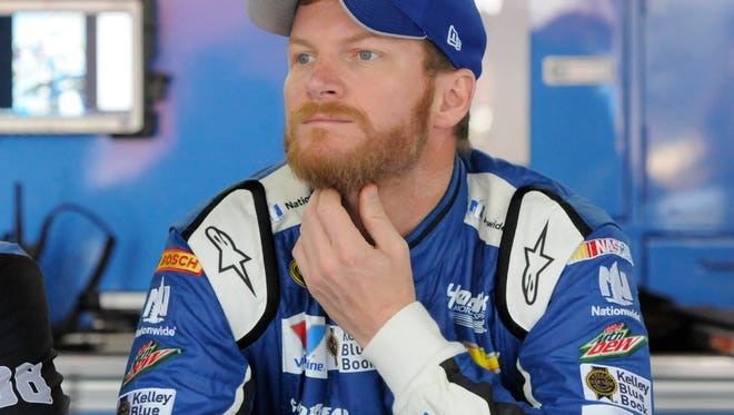 Dale Earnhardt Jr, right, waits by his car during a May stop at Charlotte Motor Speedway.