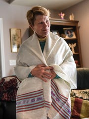Judith Wood, who lives in Alden Place recently returned from Ethiopia after a mission trip with Life Water shows an Ethiopian shawl given to her on Tuesday, March 1, 2016.