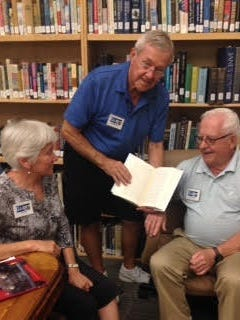 Library volunteers Jill Roff, Bill Hamann and Dave Hubert make using the new Reference and Research Library at the Elliott Museum easy.