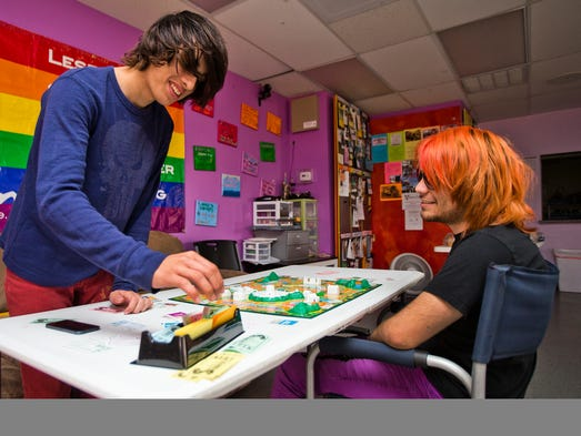 Students Nick da Silva (left) and Avery Bernasconi, both 16, play the game of Life during lunch at the One-N-Ten's Q High in Phoenix.