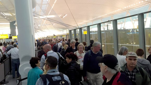 Passengers wait in a long Transportation Security Administration