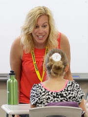 Teacher Melanie Nyquist encourages her 3rd and 4th grade Resource Math students during summer sessions at Bay Port High School July 6, 2016.
