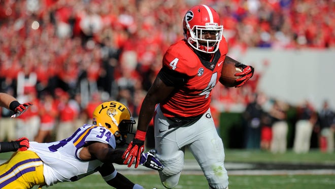 Georgia running back Keith Marshall (4) runs past LSU safety Micah Eugene (34) during the second quarter Saturday at Sanford Stadium. Marshall got even more work than usual after Todd Gurley suffered an ankle injury in the first half.
