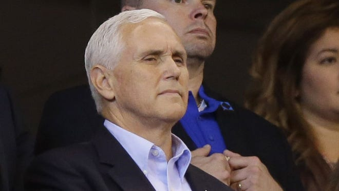 Vice President Mike Pence and his wife, Karen, stand during the playing of the national anthem before a game between the Indianapolis Colts and the San Francisco 49ers,
