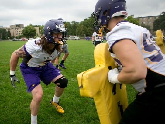 Aaron Karlen, left, goes through a drill with teammate