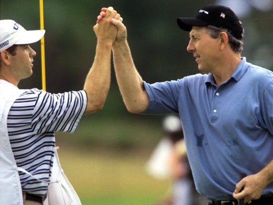 Winner Hale Irwin, right, and his caddie, Kenny Harms,