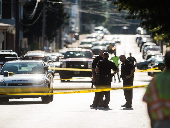 Police investigate a shooting that occurred at the