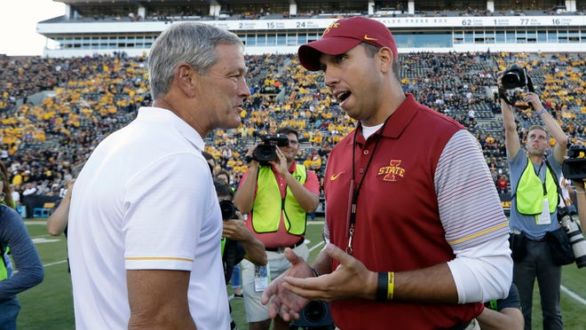 Kirk Ferentz, left, and Matt Campbell will have to wait until perhaps 2021 for their fifth coaching matchup. Ferentz and the Hawkeyes have won all four meetings against the Campbell-coached Cyclones.