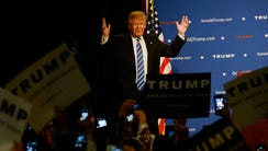 Donald Trump acknowledges the crowd before speaking
