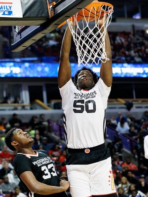 West center Caleb Swanigan, right, of Fort Wayne Homestead, dunks as East center Diamond Stone of Dominican in Whitefish, Wis., watches during the first half of the McDonald's All-American boys basketball game in Chicago on Wednesday.