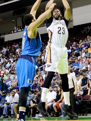 Anthony Davis of the New Orleans Pelicans shoots the ball  during their game against the Dallas Mavericks Saturday evening at CenturyLink.