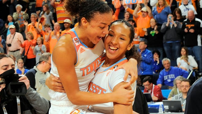 Tennessee Lady Volunteers guard Andraya Carter, left and center Mercedes Russell react as their team defeats the Kentucky Wildcats at The Arena at Gwinnett Center.