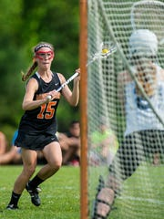 Middlebury's Andi Boe, left, shoots and scores on MMU's