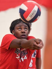 Bryana Calwise bumps a ball during practice at Belton-Honea