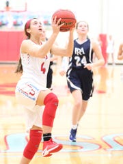 USJ's Morgan Williams hits a layup after a steal against