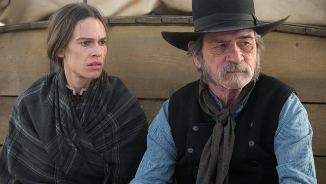 "Tommy Lee Jones and Hilary Swank in ""The Homesman."""