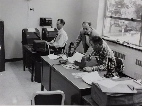 LSJ reporter Dick Frazier, center, and others in the