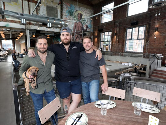 Owners John Nealon, holding Dallas, chef Christian