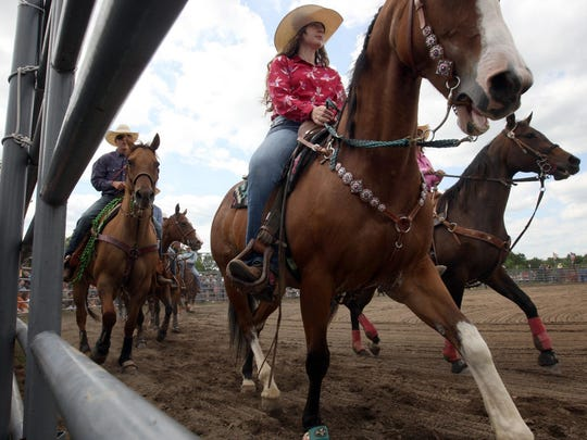 A parade of the competitors at the start of the 22nd Montgomery Rodeo Sunday, June 7, 2015 in Skillman, NJ, on the grounds of the Daube Farm. Jody Somers / For The Courier News