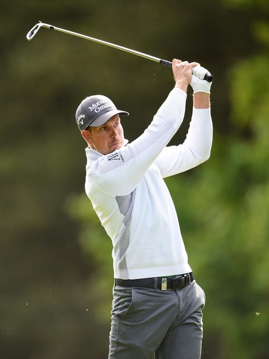 Sweden's Henrik Stenson plays a shot with an iron during day two of the BMW PGA Championship at the Wentworth Club,  Virginia Water,  England Friday May 23, 2014. (AP Photo/Adam Davy/PA) UNITED KINGDOM OUT