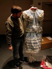 Farmington Museum curator Jeffrey Richardson displays