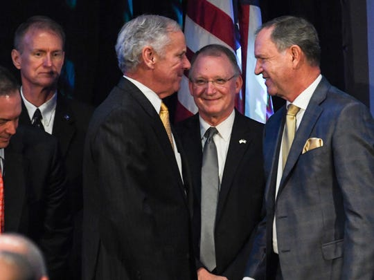 South Carolina Gov. Henry McMaster, left, and Reinhold Schmieding, right, founder and president of Arthrex, talk at the Arthrex announcement at the Civic Center of Anderson on Monday.