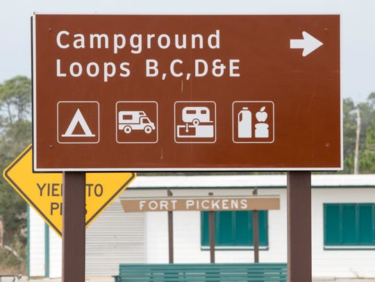 Signs direct visitors to the Fort Pickens campgrounds