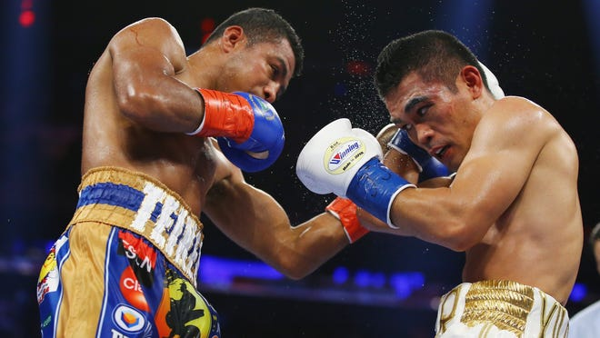 NEW YORK, NY - OCTOBER 17:  Roman Gonzalez punches Brian Viloria during their WBC Flyweight Title fight at Madison Square Garden on October 17, 2015 in New York City.  (Photo by Al Bello/Getty Images) ORG XMIT: 567656971 ORIG FILE ID: 493147778