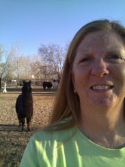 Owner Karen Freund poses with Laney, one of two llamas