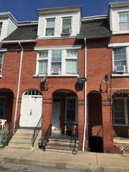 This modest rowhouse on West Poplar Street in West