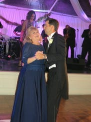 Debbie Shaughnessy dances   with the groom - her son