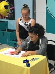 Hernandez signs an autograph for a Beach Bounders gymnast.