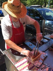 Randy Simpson prepares his 28,000th hot dog after nearly