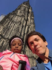 Chika, 6, and Mitch Albom in front of the Cologne Cathedral