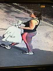 A surveillance image of the suspect who stole a delivery